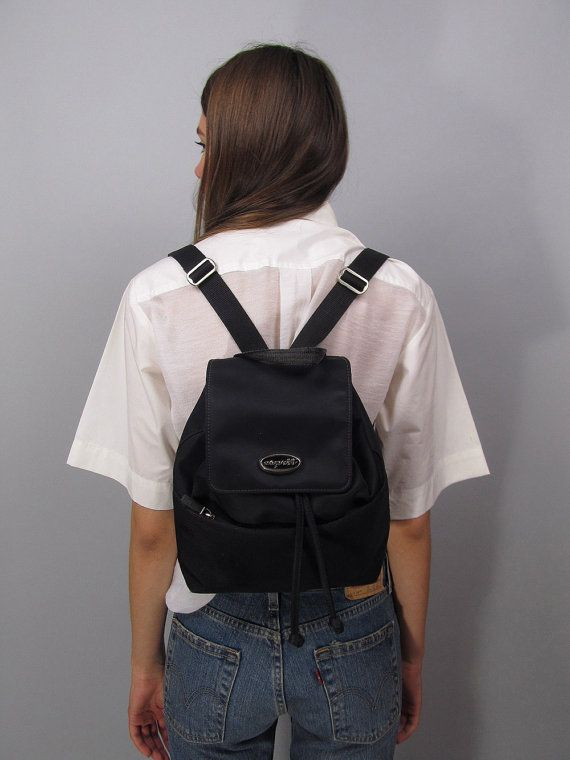 △ D E T A I L S △ Vintage 90s Esprit backpack. A staple of the 90s this cute bag is made of black nylon fabric (super easy to clean), it has