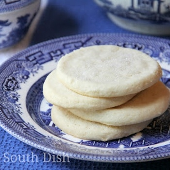 Old Fashioned Southern Tea Cakes-Old fashioned, authentic southern tea cakes are basic, simple sugar cookies in their list of ingredients - butter, sugar, flour and eggs - but they speak so much more to our history, heritage and memories.