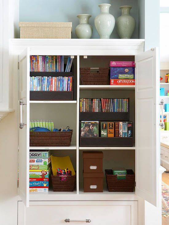 No matter how well-organized -- or accurately alphabetized -- they might be, movies and video games usually read as clutter when they're lined up on open shelves. Instead, store cases in boxes that both look good and keep everything organized. Set up separate containers for kids' movies, parents' movies, and video games. Label each box so the cases get put back in the right spots.
