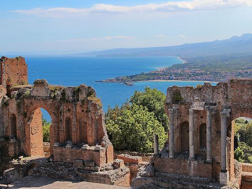 Ancient theatre of Taormina - A famous ancient Greek amphitheatre with a spectacular view to the sea in the background