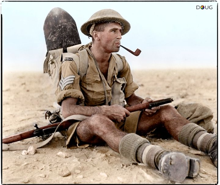 WW2 Colourised Photos New Zealand Army Sergeant Ian Thomas smoking a pipe during the North African Campaign in Egypt 1942.  25th Battalion, 6th Infantry Brigade, 2nd NZEF.   (National Library of NZ Ref. DA-02581-F. Object #29771)
