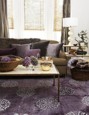 Modern living room with purple rug, chocolate brown sofa couch, purple cushions and brown curtains