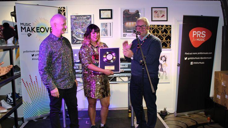 Producer Steve Levine, Lisa Barlow Weber and Nigel Elderton with the Gold disc