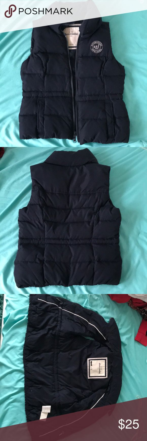 Abercrombie Kids navy blue bubble vest Abercrombie bubble vest in great condition, name scratched out on tag.  No stains or sign of distress abercrombie kids Jackets & Coats Vests