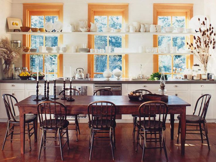 This Tom Bosworth-designed kitchen has a large table that would be great for family gatherings, but its height would be a bit low to use for food prep.