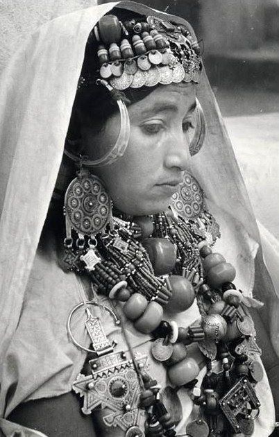 Africa | Chleuh woman in full dress of the Anti-Atlas in the south-western part.  Morocco | ca. 1950