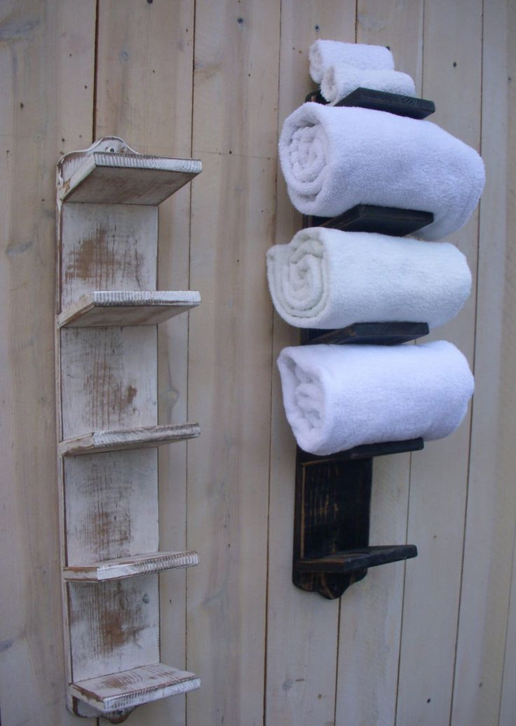 Wall Mounted Rustic Wood Towel Storage Hanging On Wooden Wall With  Organizing Bathroom Closet Plus Towel Shelves For Small Bathrooms.