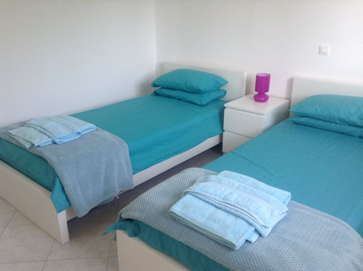 The kingfisher blue upstairs twin bedroom