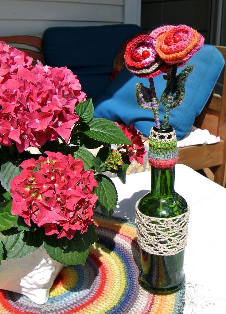 crochet flowers in a sherry bottle