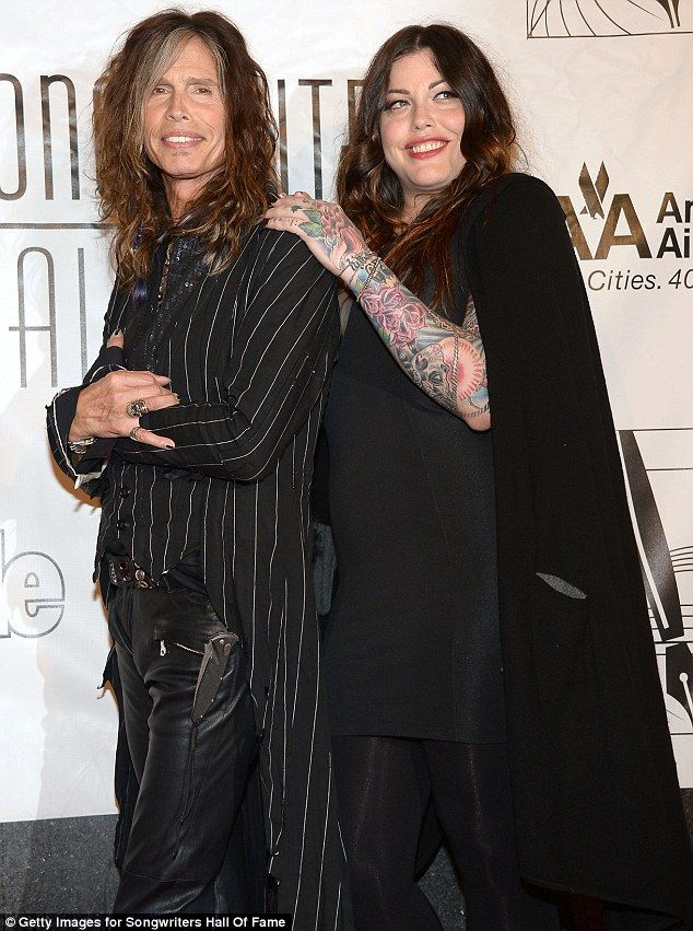 All in the family: Steven Tyler also brought along daughter Mia Tyler, who wore multiple layers of black and exposed her sleeve of tattoos