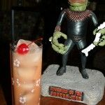 Acapulco Zombie:1 ½ oz tequila  1 ½ oz vodka  1 ½ oz dark rum  2 oz orange juice  2 oz grapefruit juice  1 tsp grenadine  dash or two of white crème de menthe  Shake all ingredients except crème de menthe in a shaker till cold. Pour into a hi-ball glass over ice & top with a couple dashes of the crème de menthe. Stir softly and garnish with a maraschino cherry.