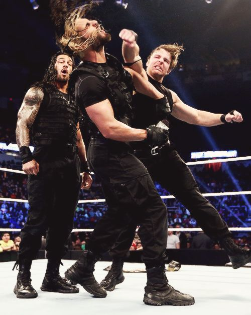 Dean Ambrose punching Seth Rollins during the Shield ...