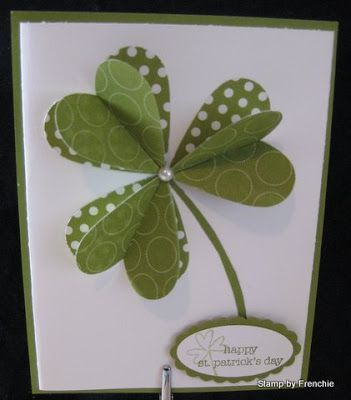 jjhandmade St. Patrick's Day card from Stamp & Scrap with Frenchie pretty variation of the heart shamrock ... two layers of hears with different green patterned papers ... like the polka dots and then a small white pearl as the cent ... top layer with leaves bent up ... clean and simple ... great card!: