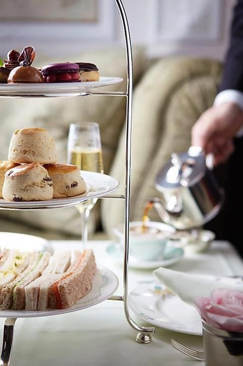 Tea, this is the way tea should be done,  sandwiches on the bottom, scones in the middle, sweets on top and a man pouring!!!