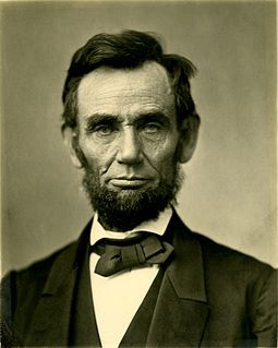 An iconic photograph of a bearded Abraham Lincoln showing his head and shoulders.