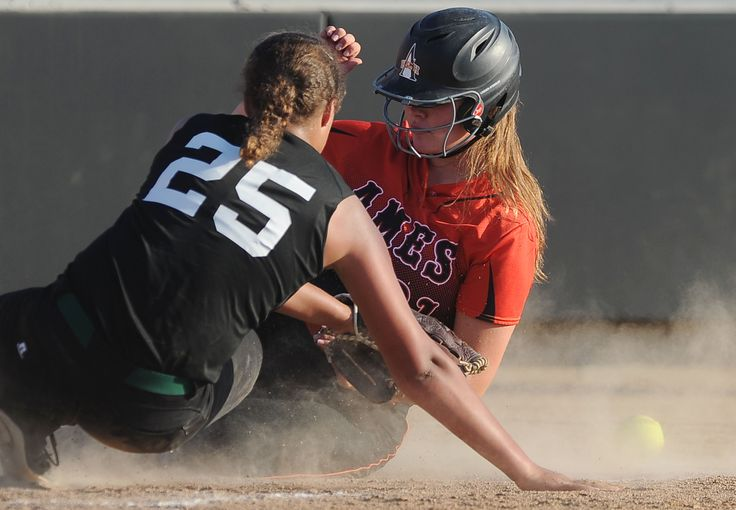 Ames' Alexa Linder scores on a wild pitch in the first inning of the Little Cyclones' 22-0 victory against Des Moines North in a Class 5A regional first-round game on Thursday in Ames. Photo by Nirmalendu Majumdar/Ames Tribune http://www.amestrib.com/sports/20170706/softball-ames-cruises-into-regional-semis