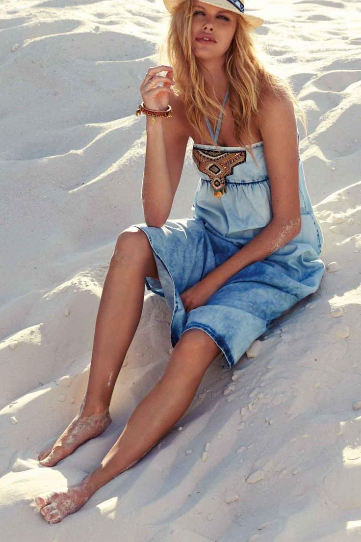 Festival styled boho denim maxi dress from Watercult beachwear. Perfect for looking effortlessly cool whilst travelling the islands or hitting the bars on hot summer evenings. Made from a cool cotton mix with easy fit smocking detail & tassel trims, definitely a staple dress that could be dressed up or down.    S = UK 8 / 10 M = UK 12 L = UK 14 / 16   Boho Denim Dress by WATERCULT. Clothing - Dresses - Maxi London