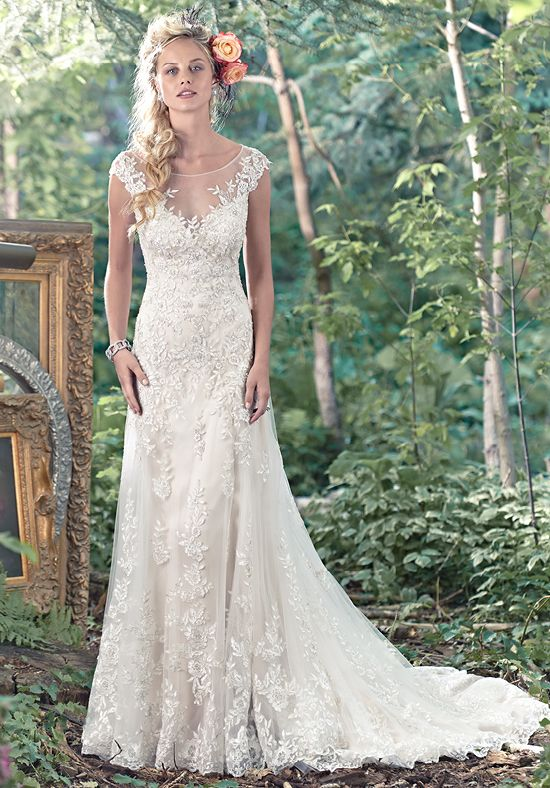 A stunning illusion back and feminine illusion sweetheart neckline, edged in floral lace appliqués, takes center stage in this Vogue satin A-line slip dress with lace and tulle overlay. Finished with covered buttons over zipper closure.