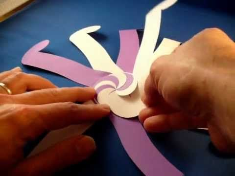 Paper sculpture... Ten-Sided Yin-Yang Globe Assembly (video tutorial) Gorgeous example here: http://pinterest.com/pin/268597565249157135/ ... And a pictorial here: http://origami.oschene.com/archives/2012/01/25/ten-sided-yin-yang-globe/