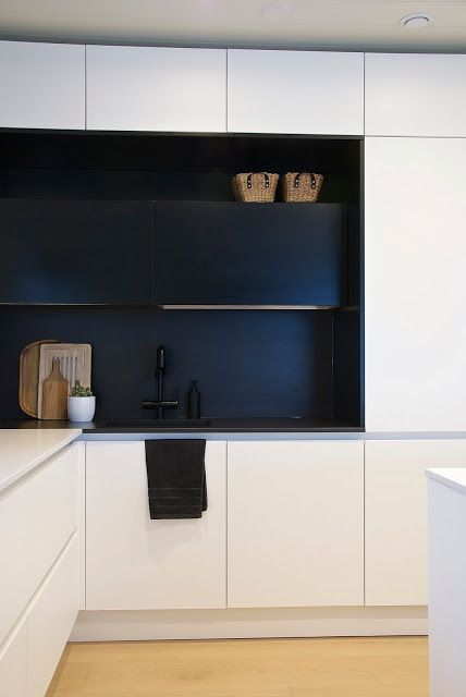 talo markki -modern black and white kitchen