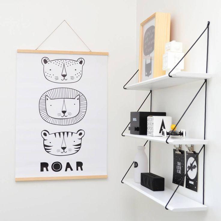 Veikeitä eläinhahmoja ja yksityiskohtia lastenhuoneen seinällä