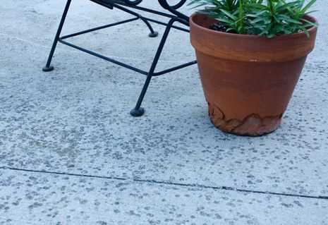 How to clean mildew and algae off of your patio.  Items you will need is:    Oxygen bleach (not chlorine bleach)  Warm Water  Stir Stick  Heavy Duty Push Broom  Elbow Grease,   or  you can go and buy and pressure washer if you don't already have one.