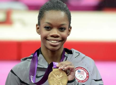 Gabby Douglas celebrates her gold medal in the women's gymnastics all-around final.