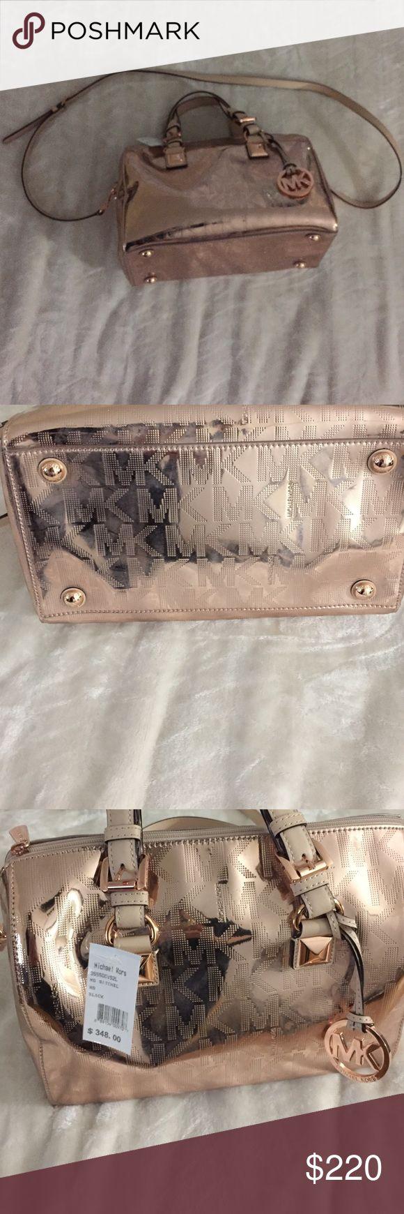 Michael Kors Metallic Satchel Brand new Michael Kors Metallic Bowler bag. Price tag attached. Never used. Comes along with cross body.  Original price $348 Michael Kors Bags Satchels