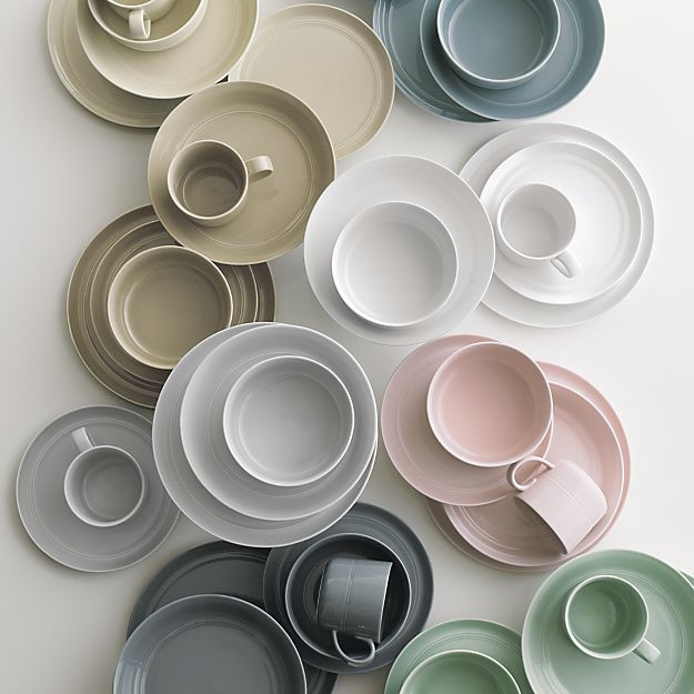 Our fresh, contemporary porcelain pattern from designer Aaron Probyn tells a mix 'n' match color story, hand-glazed in eight soft, soothing hues. Simple artisanal shapes feature grooved detailing and a glowing, glossy finish, here in graphic dark grey. Due to their handcrafted nature, slight variations will be present.