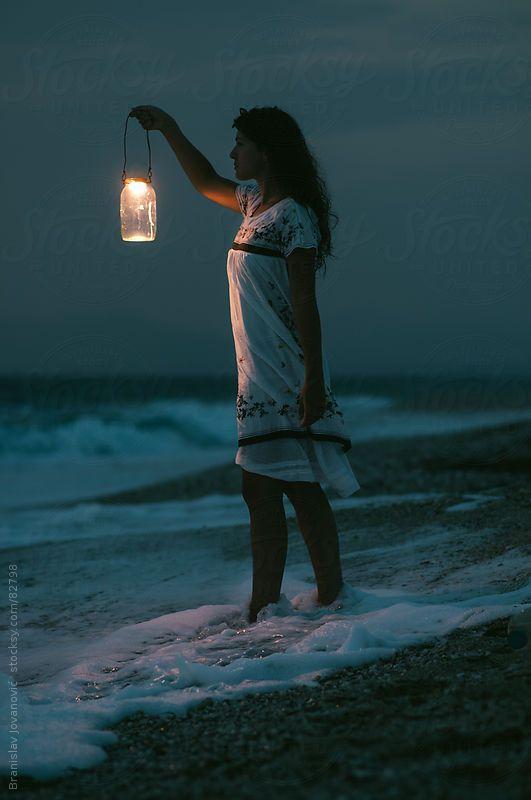 Woman With Lantern on Coast by Branislav Jovanović