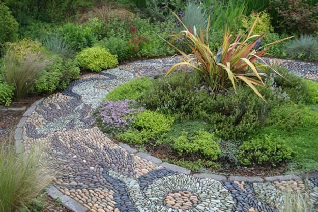 Pebble mosaics, which utilize naturally rounded stones in various colors to create patterns and images.