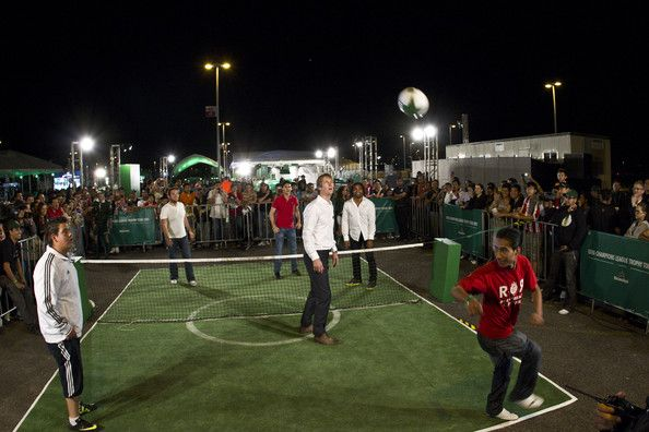 UCL Trophy Tour ambassadors Christian Karembeu and Edwin Van der Sar play soccer with fans at the Fan Zone as part of the UCL Trophy Tour at Omnilife Stadium on March 10, 2012 in Guadalajara, Mexico.