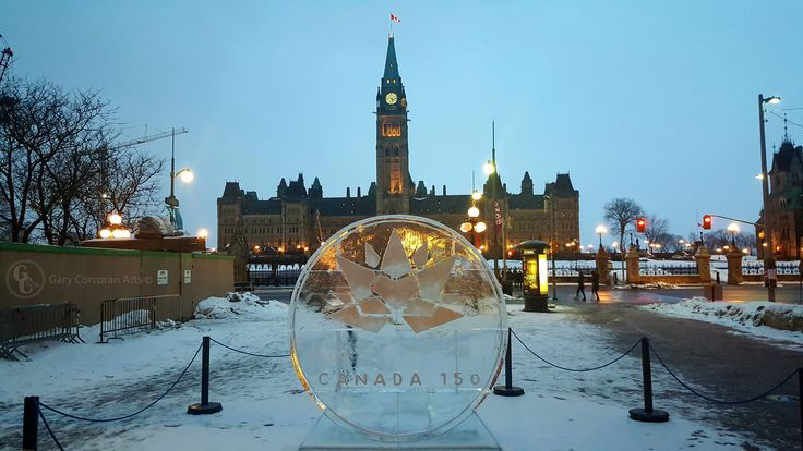 """A golden year - celebrating Canada's 150th anniversary"" - This is a mobile phone photo I took of a newly made ice sculpture made in front of the Capital Information kiosk 90 Wellington St. Ottawa, ON, CAN. Made a colorful image celebrating an important year in Canada this year of 2017."