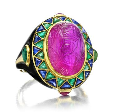 Cartier~An Egyptian Revival Ruby,  Emerald, Sapphire and Enamel Ring,  circa…