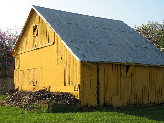 don't often see a yellow barn