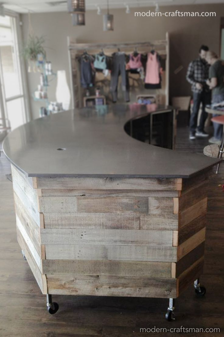 craftsman style wood and concrete reception desk for yoga studio in Utah by Modern Craftsman