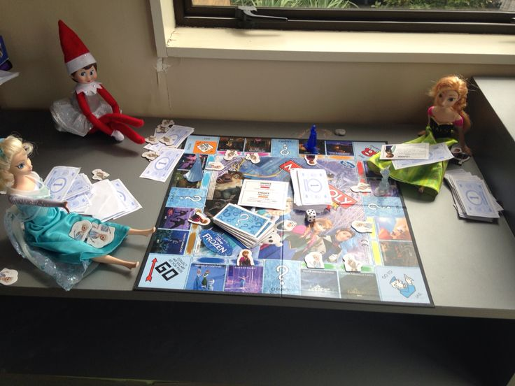Elf on the shelf playing frozen monopoly with Anna and elsa. Pic only