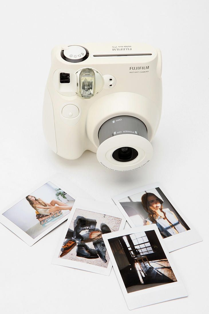 A mini polaroid camera? How adorable is that?! from Urban Outfitters.