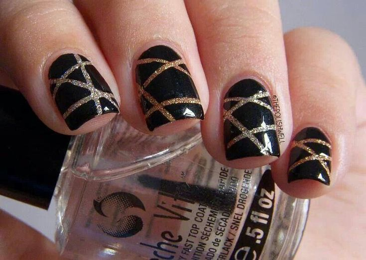 Striped black and gold nails