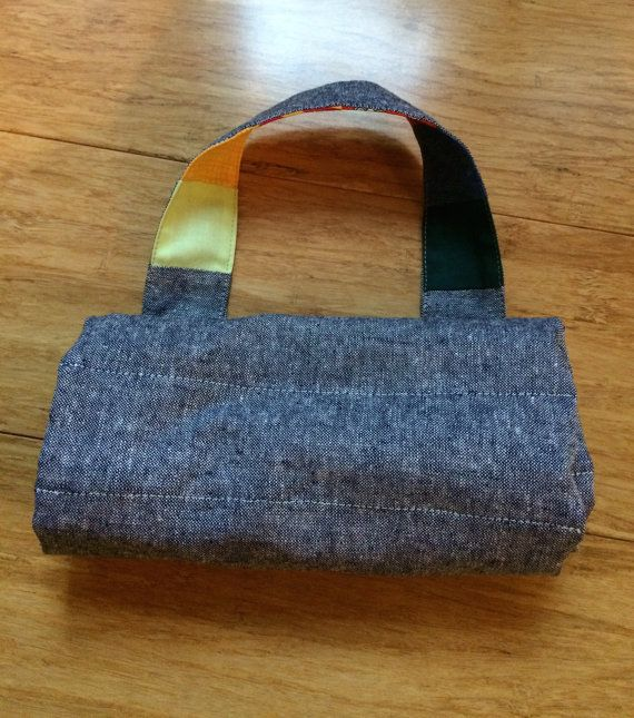 This is a listing for a handmade crayon pouch to fit 12 Stockmar block and 12 Stockmar stick crayons. I used an assortment of premium quilting cotton fabrics for the colorful front and a cotton/linen blend for the back of the pouch. Can be easily rolled up and carried around. Please