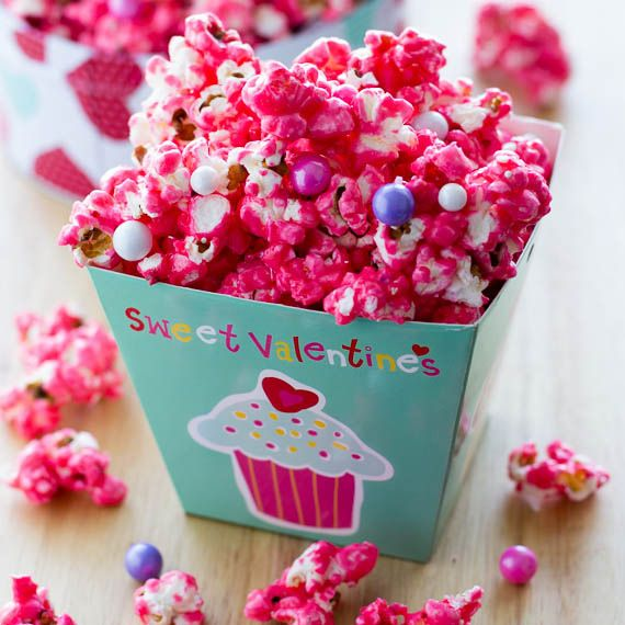 Easy candy popcorn recipe. Flavored popcorn with sprinkles and Sixlets making this a fun popcorn snack.