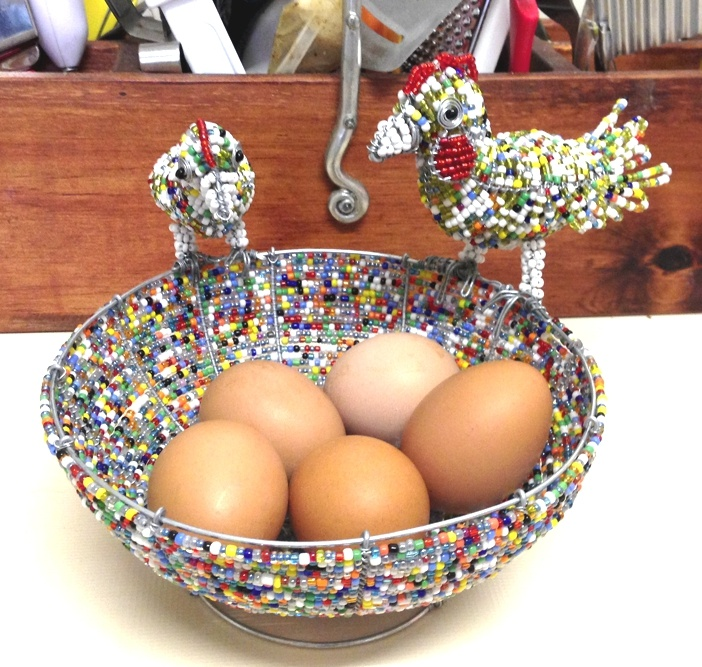 A Proudly Stribal Creation.  Our colorful wire beaded handcrafted egg bowl with a Rooster and Hen guarding over the eggs.    For more Stribal Wire Beaded Animal Artworks please see here:http://www.stribal.com/artworks/beaded-artworks/animals-and-creatures.html