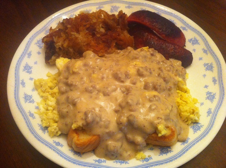 Seriously the Best Breakfast EVER! French toast made with texas toast topped with eggs and sausage gravy, homemade hash browns with onions and red hot sausage links.