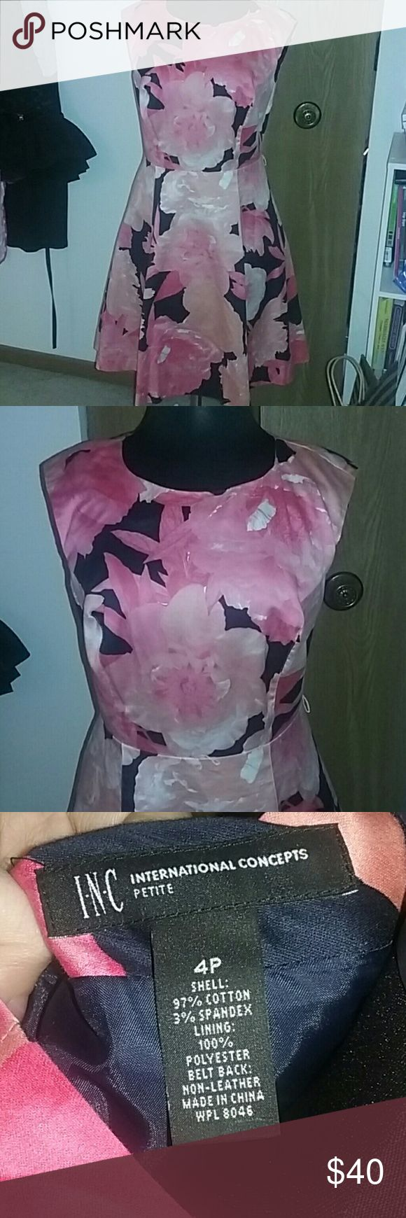 Floral fit and flare dress Inc International Concepts floral fit and flare sleevless dress. Size 4P. Kept in excellent condition. About knee length depending on height. Colors are : pink, orange, coral, white, and navy blue. Dress has two layers, bottom is navy blue, but not visible, only to keep top layer from being see through INC International Concepts Dresses Midi