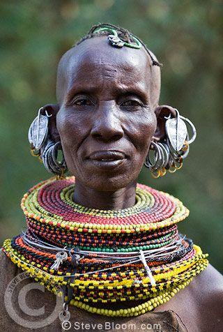 Turkana tribeswoman, with multiple earrings and elaborate bead collar, Lake Turkana, Northern Kenya, Africa.