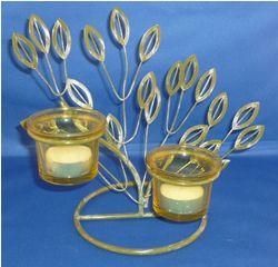 Decorative Green Tree Tea Lite Holder from Absolute Angels Green Tea Lite holder with decorative green leaves Comes complete with tea lite candles ready for use Approx 19cm tall 21cm wide £4.99