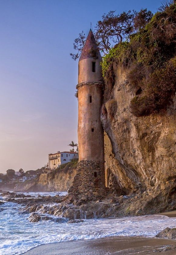 THE PIRATE TOWER, USA ~ A Laguna Beach (California) landmark, this medieval-looking tower is located just north of Victoria Beach. Built in 1926, it was designed as a private spiraling staircase for beach access from above. Today the tower is closed but can still be viewed from the outside at low tide.