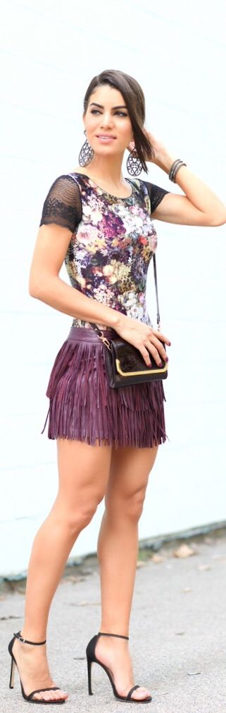 Camila Coelho burgundy fringed leather miniskirt and ankle strap heels