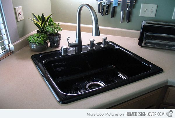 15 Cool Corner Kitchen Sink Designs - Small Kitchen Sink | Image: The Kitchen Dahab | With its modern faucet design, this kitchen sink is a stunner, also, thanks to the sleek color black used for the fixture. The color sure pops!