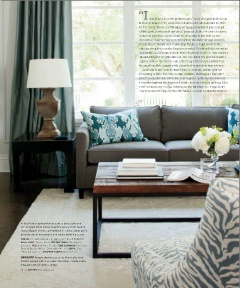 I love the clean look created by dark Gray sofas and a mix of blue accents.